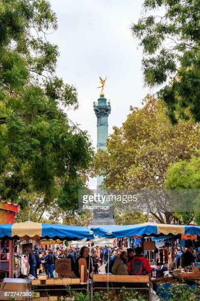 bastille market with the july column in background - bastille stock photos and pictures