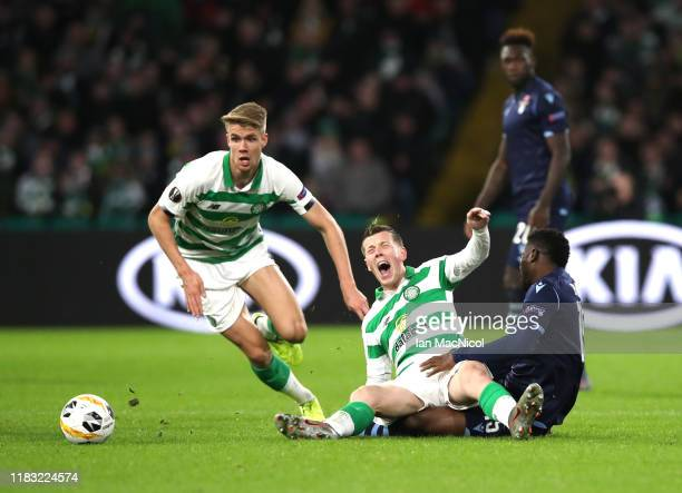 Bastos of Lazio brings down Callum McGregor of Celtic during the UEFA Europa League group E match between Celtic FC and Lazio Roma at Celtic Park on...