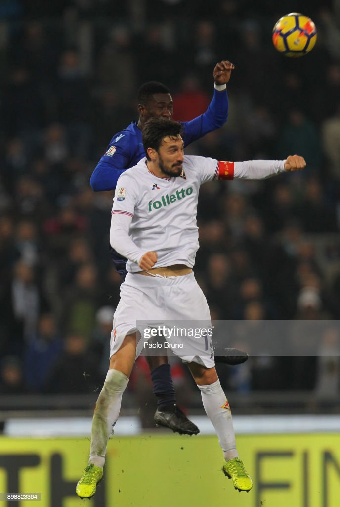 Bastos of SS Lazio competes for the ball with Davide Astori (R) of ACF Fiorentina during the TIM Cup match between SS Lazio and ACF Fiorentina at Olimpico Stadium on December 26, 2017 in Rome, Italy.