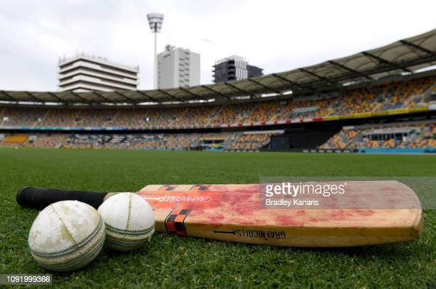 Bat and balls can be seen as players warm-up before the Brisbane Heat v Melbourne Stars WBBL match at The Gabba on January 10, 2019 in Brisbane,...
