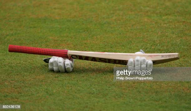A bat and batting gloves are left on the ground during the tour match between international XI and the Pakistanis at The Oval London 10th July 2006