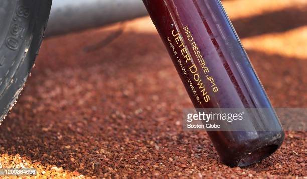A bat belonging to Infielder Jeter Downs is pictured leaning against a batting cage during the first official Red Sox Spring Training workout at the...