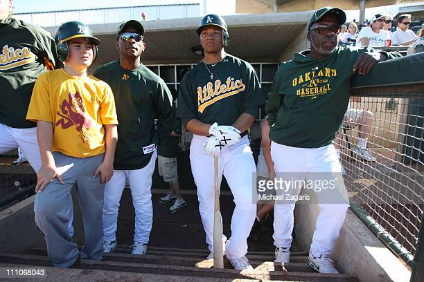 Bat boy Hall of Famer Rickey Henderson with number one draft pick Michael Choice and Batting Coach Gerald Perry of the Oakland Athletics during the...