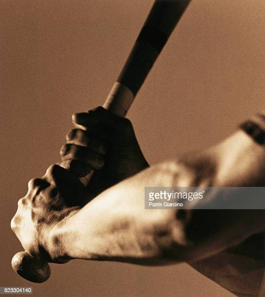 bat in batter's hands - batting sports activity stock pictures, royalty-free photos & images