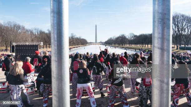 Batalá Washington an allwomen AfroBrazilian band performed on the steps of the Lincoln Memorial facing the Washington Monument for the quotWomen's...