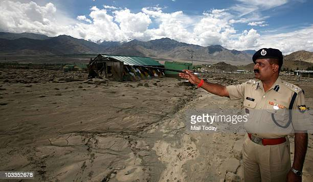 Batallion Commandant RS Pathak surveying area damaged by flash floods in batallion area on August 11 2010 At least 156 people have been killed and...