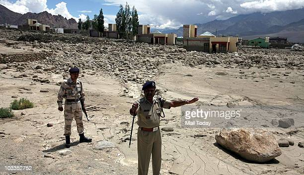 Batallion Commandant RS Pathak surveying area damaged by flash floods in batallion area At least 156 people have been killed and scores remained...