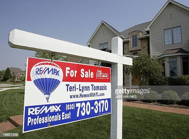 Batavia, UNITED STATES: A home sits for sale 25 July, 2007 in Batavia, Illinois a suburb outside of Chicago. Existing home sales in the United States...