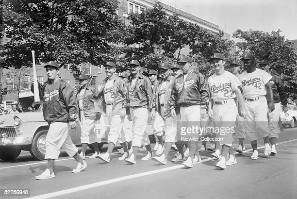 Batboy Charlie DiGiovanni Billy Herman manager Walter Alston pitching coach Joe Becker coach Jake Pitler Pee Wee Reese Don Zimmer and Jackie Robinson...