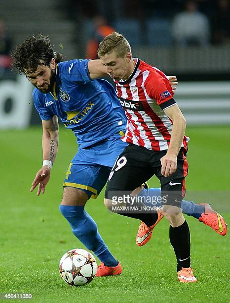 Bate Borisovs Anri Khagush fights for the ball with Athletic Bilbaos Iker Muniain on September 30 2014 during a UEFA Champions League group H...