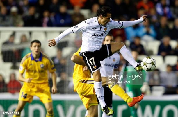 Bate Borisov's defender Denis Polyakov vies with Valencia's Mexican midfielder Jose Andres Guardado during the UEFA Champions League football match...