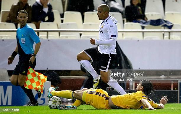 Bate Borisov's defender Yegor Filipenko tackles Valencia's French midfielder Sofiane Feghouli during the UEFA Champions League football match...