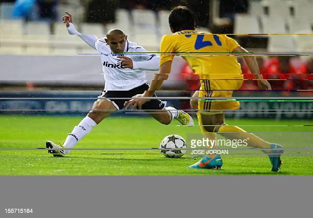 Bate Borisov's defender Yegor Filipenko vies with Valencia's French midfielder Sofiane Feghouli during the UEFA Champions League football match...