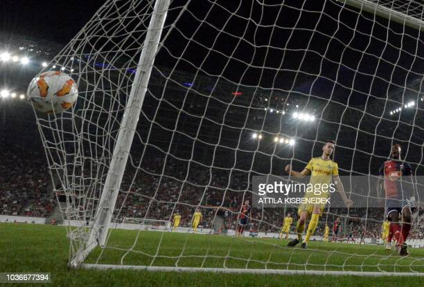 Bate Borisov's Finnish forward Jasse Tuominen scores during the UEFA Europa League football match between Vidi FC and FC BATE Borisov in Budapest on...