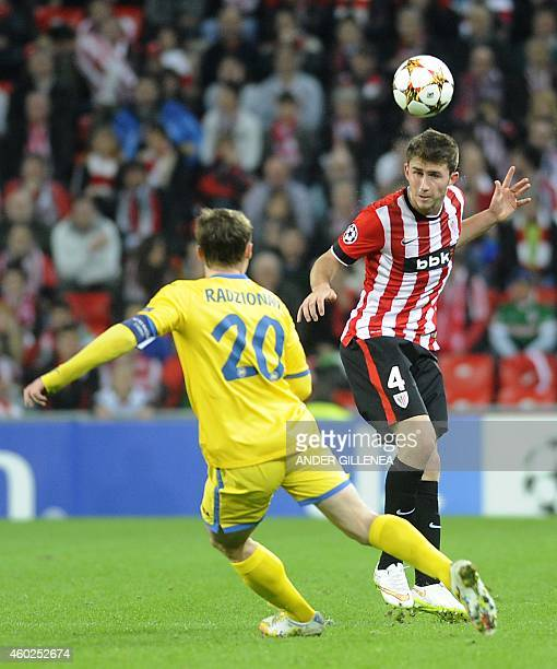 Bate Borisov's forward Vitali Rodionov vies with Athletic Bilbao's French defender Aymeric Laporte during the UEFA Champions League Group F football...