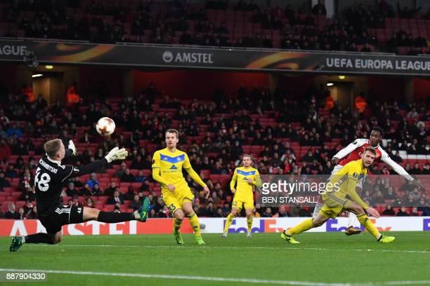 Bate Borisov's goalkeeper Denis Scherbitskiy saves a shot at goal by Arsenal's English striker Danny Welbeck during the Europa League Group H stage...