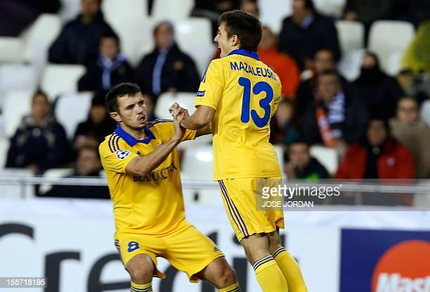 Bate Borisov's midfielder Dmitri Mozolevski celebrates with Bate Borisov's midfielder Aleksandr Volodko after scoring during the UEFA Champions...