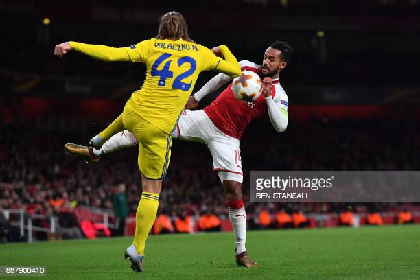 Bate Borisov's midfielder Maksim Valadzko vies with England's striker Theo Walcott during the Europa League Group H stage football match between...