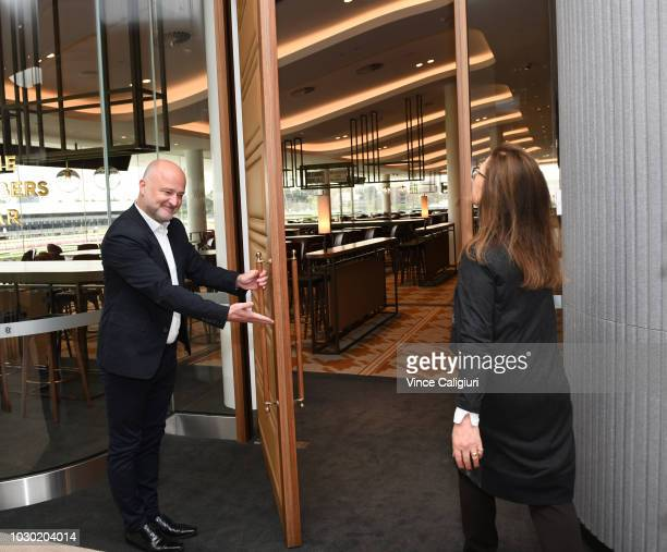 Bates Smart Director of Architecture Kristen Whittle opens The Members Bar door for VRC Chairman Amanda Elliott during a media preview of the new...