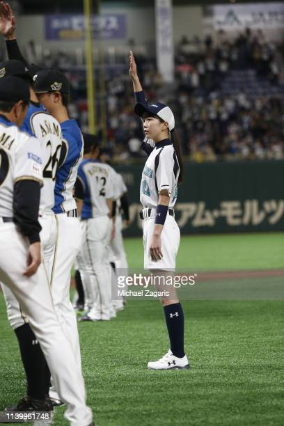 A batgirl stands on the field prior to the game between the Oakland Athletics and the Hokkaido NipponHam Fighters at the Tokyo Dome on March 17 2019...