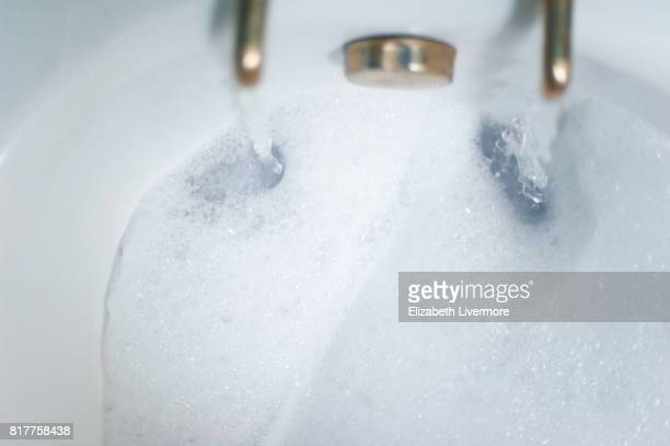bath being drawn - bubble bath stock pictures, royalty-free photos & images