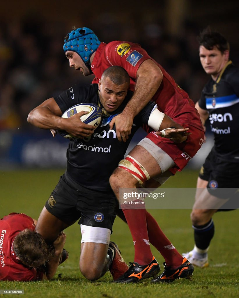 Bath centre Jonathan Joseph is stopped by Scarlewts forward Tadhg Bierne during the European Rugby Champions Cup match between Bath Rugby and Scarlets at Recreation Ground on January 12, 2018 in Bath, England.