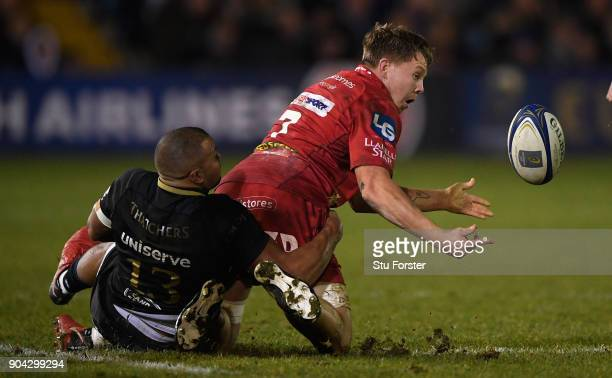 Bath centre Jonathan Joseph tackles Scarlets player James Davies as he offloads during the European Rugby Champions Cup match between Bath Rugby and...