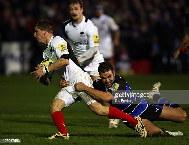 Bath centre Olly Barkley hangs onto Saracens player David Strettle during the Aviva Premiership game between Bath and Saracens at Recreation Ground...