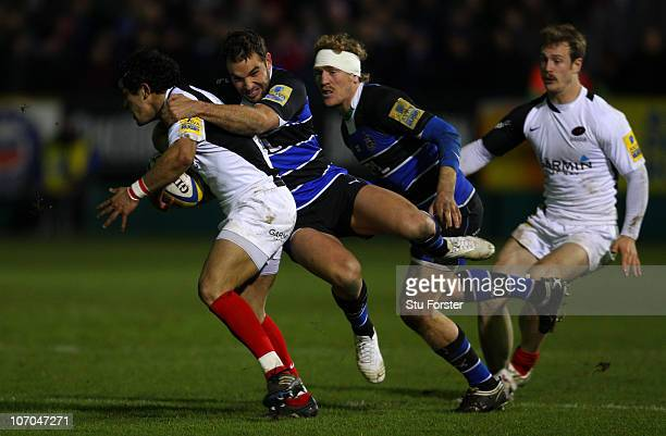 Bath centre Olly Barkley hangs onto Saracens player Sam Stanley during the Aviva Premiership game between Bath and Saracens at Recreation Ground on...