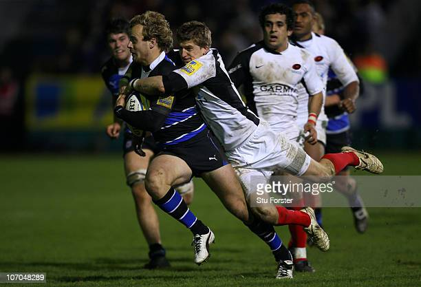 Bath full back Nick Abendanon cannot escaspe the clutches of Saracens player David Strettle during the Aviva Premiership game between Bath and...