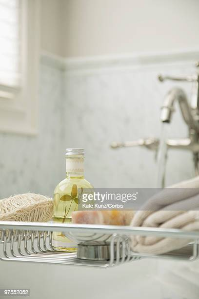 bath oil on bath rack - loofah stock photos and pictures