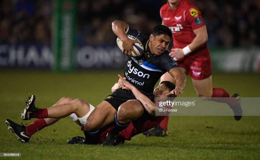 Bath player Ben Tapuai is tackled by Scarlets player James Davies the European Rugby Champions Cup match between Bath Rugby and Scarlets at Recreation Ground on January 12, 2018 in Bath, England.