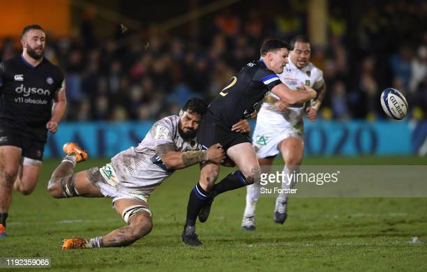 Bath player Freddie Burns looses the ball as he is tackled by Sitaleki Timani during the Heineken Champions Cup Round 3 match between Bath Rugby and...