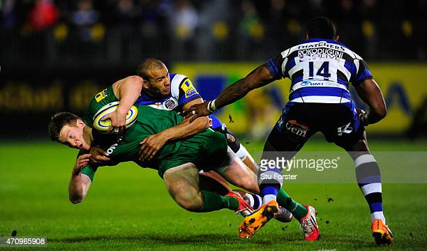Bath player Jonathan Joseph grabs hold of Eoin Griffin of London Irish during the Aviva Premiership match between Bath Rugby and London Irish at the...