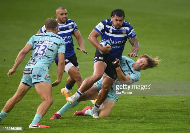 Bath player Josh Matavesi breaks the tackle of Billy Twelvetrees during the Gallagher Premiership Rugby match between Bath Rugby and Gloucester Rugby...
