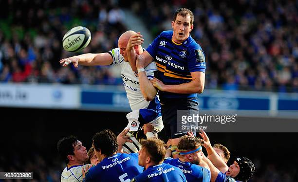 Bath player Matt Garvey is beaten in the lineout by Devin Toner of Leinster during the European Rugby Champions Cup Quarter Final match between...