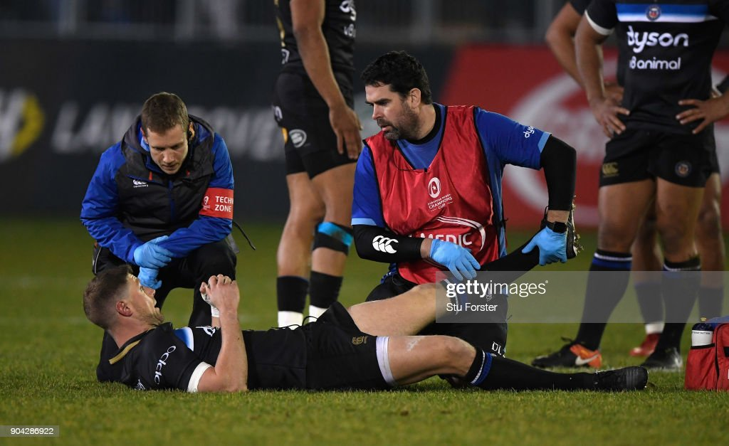 Bath player Rhys Priestland receives treatment before leaving the field with an injury during the European Rugby Champions Cup match between Bath Rugby and Scarlets at Recreation Ground on January 12, 2018 in Bath, England.