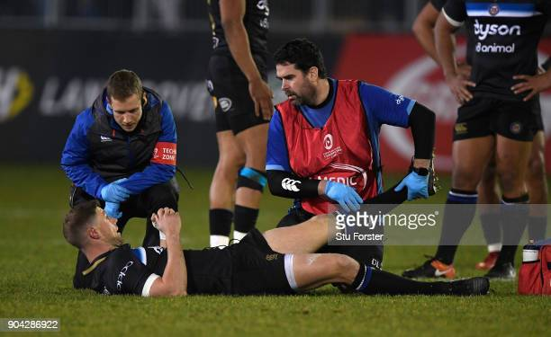 Bath player Rhys Priestland receives treatment before leaving the field with an injury during the European Rugby Champions Cup match between Bath...