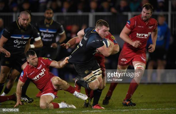Bath player Sam Underhill is pulled back by Gareth Davies during the European Rugby Champions Cup match between Bath Rugby and Scarlets at Recreation...