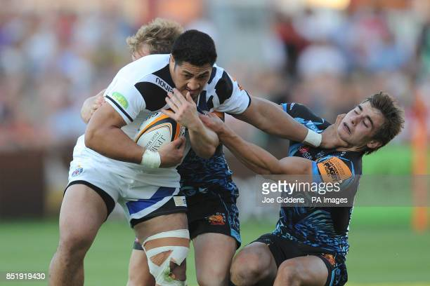 Bath Rugby 7's Alafoti Fa'osiliva hands off Exeter Chief 7's Tom Dowding during the Group A match of the JP Morgan Asset Management Premiership Rugby...