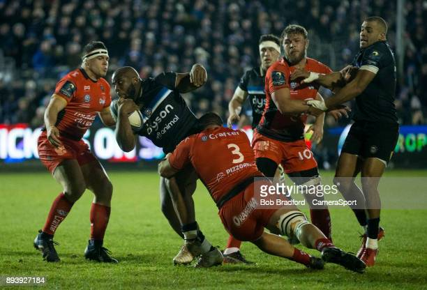 Bath Rugby's Beno Obano is tackled by Toulon's Marcel Van der Merwe during the European Rugby Champions Cup match between Bath Rugby and RC Toulon at...