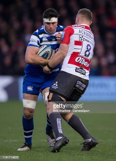 GLOUCESTER ENGLAND JANUARY Bath Rugby's Francois Louw is tackled by Gloucester's Ruan Ackermann during the Gallagher Premiership Rugby match between...