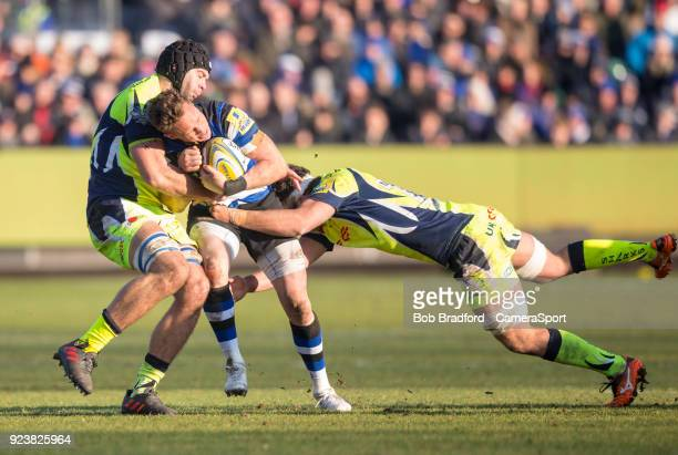 Bath Rugby's James Wilson is tackled by Sale Sharks' Jonathan Ross and Josh Beaumont during the Aviva Premiership match between Bath Rugby and Sale...