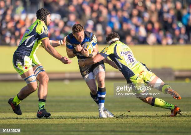 Bath Rugby's James Wilson is tackled by Sale Sharks' Jonathan Ross during the Aviva Premiership match between Bath Rugby and Sale Sharks at...