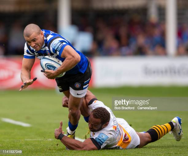 Bath Rugby's Jonathan Joseph is tackled by Wasps' Gaby Lovobalavu during the Gallagher Premiership Rugby match between Bath Rugby and Wasps at...