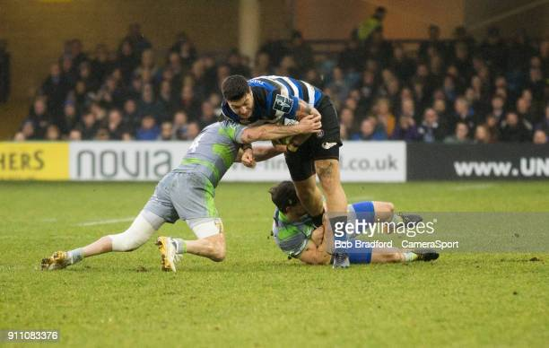 Bath Rugby's Matt Banahan is tackled by Newcastle Falcons' Dominic Waldouck and Belisario Agulla during the Anglo Welsh Cup Round Three match between...