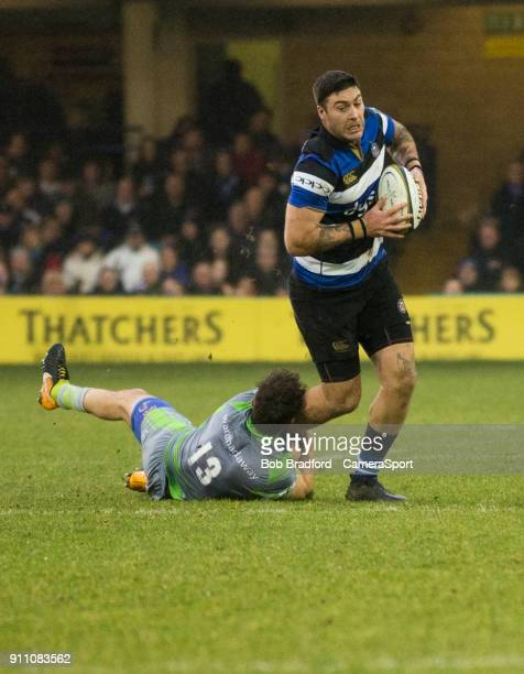 BATH ENGLAND JANUARY Bath Rugby's Matt Banahan is tackled by Newcastle Falcons' Dominic Waldouck during the Anglo Welsh Cup Round Three match between...