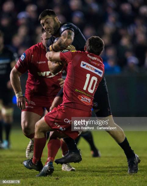 Bath Rugby's Matt Banahan is tackled by Scarlets Dan Jones during the European Rugby Champions Cup match between Bath Rugby and Scarlets at...