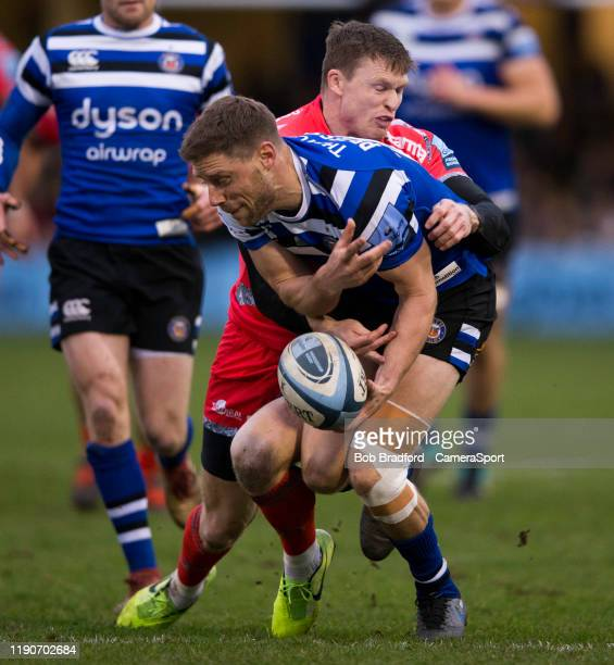 Bath Rugby's Rhys Priestland is tackled by Sale Sharks' Chris Ashton during the Gallagher Premiership Rugby match between Bath Rugby and Sale Sharks...
