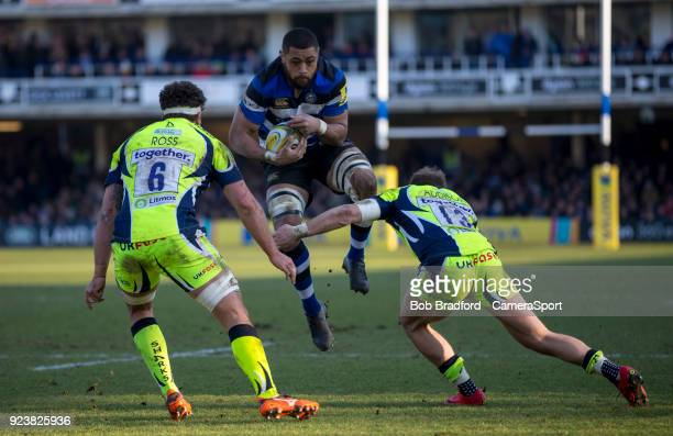 Bath Rugby's Taulupe Faletau is tackled by Sale Sharks' Will Addison and Jonathan Ross during the Aviva Premiership match between Bath Rugby and Sale...